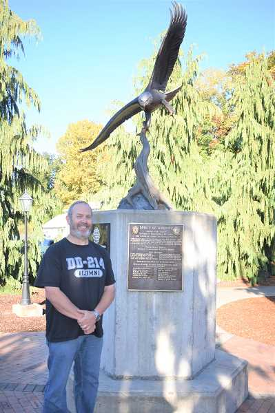PMG PHOTO: EMILY LINDSTRAND - James Moriarty stands in front of the Estacada Veterans Memorial. Moriarty served in the U.S. Army and retired as a lieutenant.