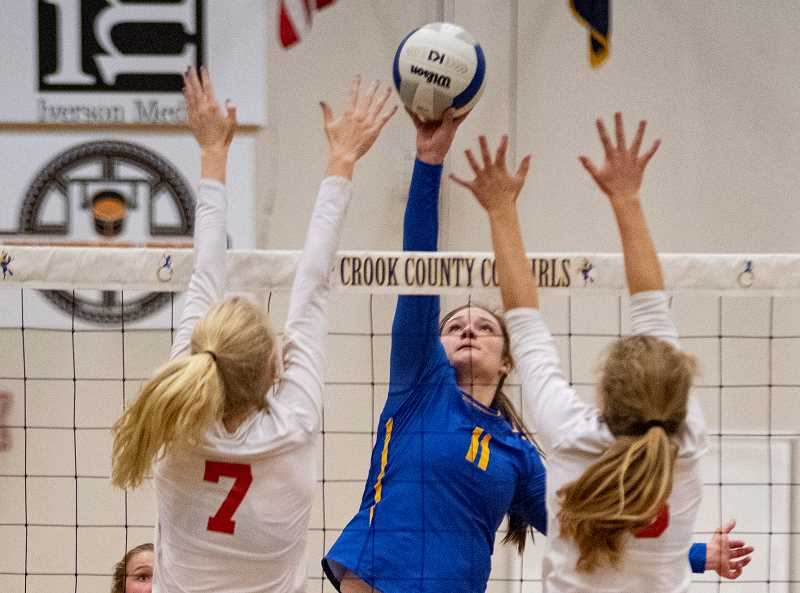 LON AUSTIN/CENTRAL OREGONIAN - Liz Barker goes up for one of her 10 kills as the Cowgirls defeated the Ashland Grizzlies in the first round of the state tournament. Crook County will face fourth ranked Corvallis on Friday in the state quarterfinals at Liberty High School in Hillsboro.
