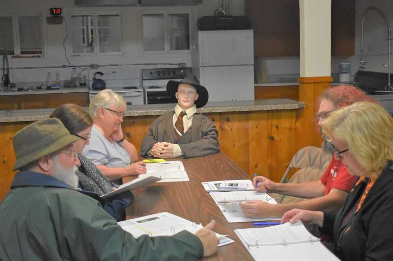 PMG PHOTO: EMILY LINDSTRAND - Rob Guttridge, Jessie Guttridge, Tami Guttridge,  Vernon Souders and Kathleen Souders are joined by a well dressed mannequin in their readers theater production of The Trouble with Harry.