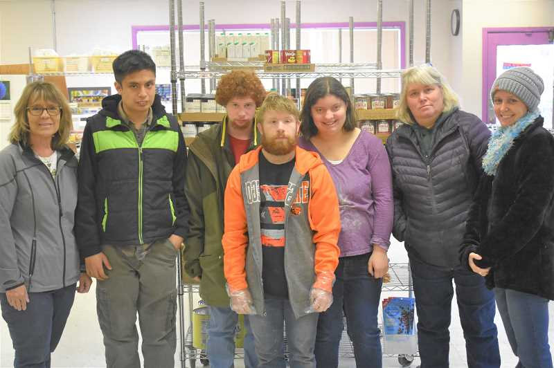 PMG PHOTO: EMILY LINDSTRAND - Adult transitions teacher Sammie Beaten, Alex Simon, Gabe Harrel, Max Spiess, Abby Bates, educational assistant Terri McReynolds and educational assistant Laura Frazey volunteer at the Estacada Area Food Bank every Wednesday.