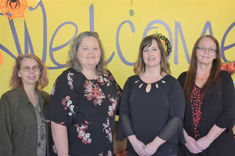 PMG PHOTO: EMILY LINDSTRAND - Peggy Hartwig, Valerie Hansen-Renteria, Trixie Hall and Jackie Fausto stand in front of the Estacada Community Center's welcome sign.