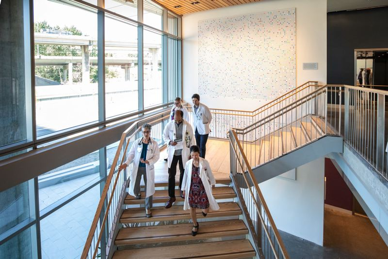 PMG FILE PHOTO - OHSU doctors check out the new Knight Cancer Research Building. The university and its labor unions are battling over working conditions and other issues.