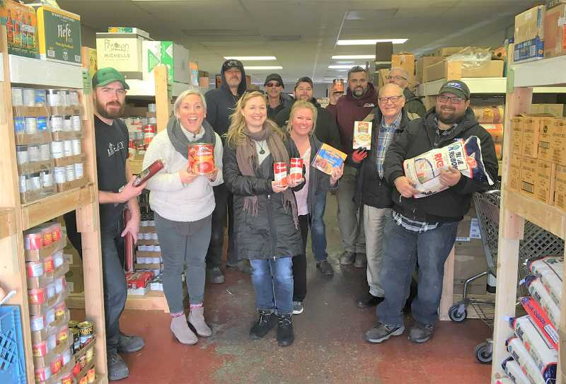COURTESY PHOTO: NORTHWEST TECHNOLOGIES - Northwest Technologies employees deliver donations to the Estacada Area Food Bank.