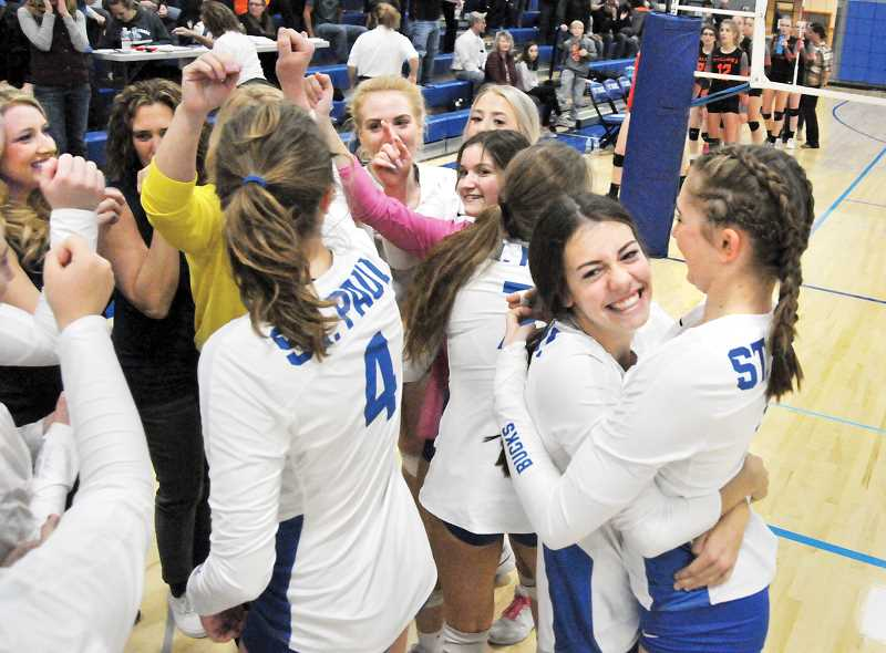GRAPHIC PHOTO: GARY ALLEN - The St. Paul volleyball team was all smiles after its first round victory in the OSAA playoffs, soundly defeating Wallowa in three sets on Saturday to advance to the state quarterfinals.