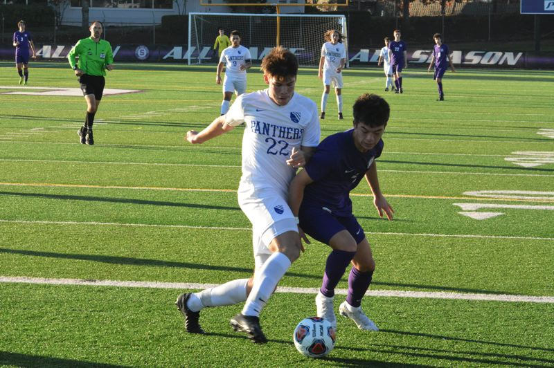 TIMES PHOTO: MATT SINGLEDECKER - Sunset senior Ellis Harwood and the Apollo boys soccer team shut out South Medford in the Class 6A first round.