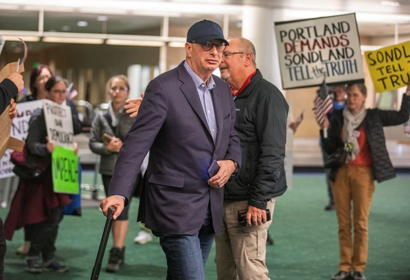 PMG PHOTO: JONATHAN HOUSE - Portland hotelier turned Trump-appointed diplomat Gordon Sondland was surprised to be greeted by protesters at Portland Internatinal Arfport Tuesday night after returning from Washington, D.C., where he'd amended his testimony to Congressional impeachment investigators.