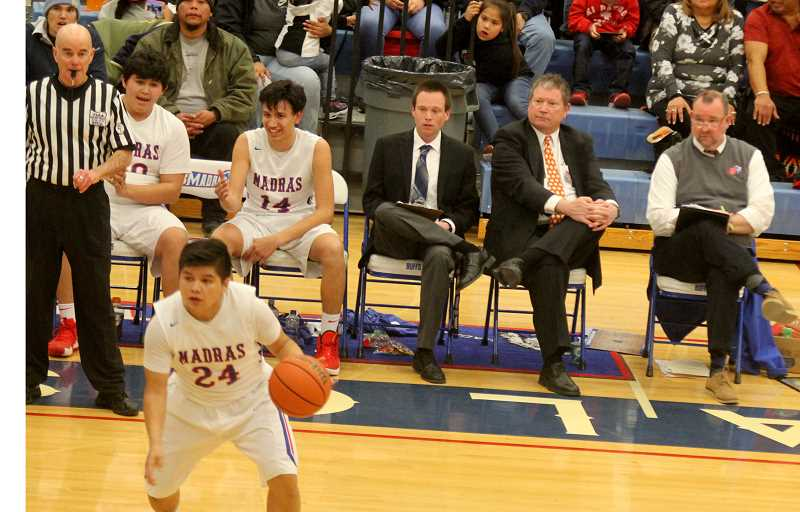 STEELE HAUGEN - Nick Brown, middle, sits next to father and longtime Madras boys basketball coach Evan Brown, right. Nick Brown has been hired as the new Madras boys basketball head varsity.