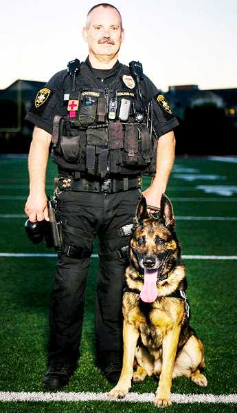 PHOTO COURTESY OF NDPD - Officer Steve Schoening has teamed with Arko for the past nine years.
