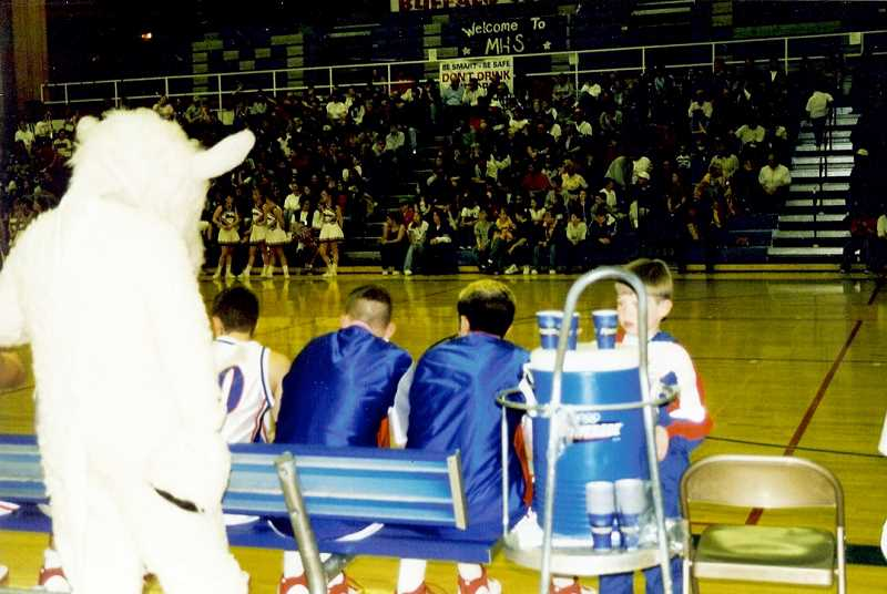SUBMITTED PHOTO - Nick Brown is the waterboy for a Madras boys basketball team in the 1990s, while his father, Evan was coaching the team.