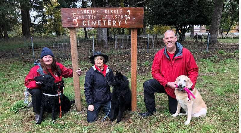 COURTESY PHOTO - (From left) Michelle Schireman and Cole, Becky Irving and Quint, and Scott Lee and Nexus offered their services recently to help find lost graves a the Dibble Jackson Austen Larken Pioneer Cemetery in Molalla.