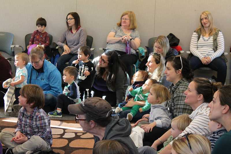 PMG PHOTO: HOLLY BARTHOLOMEW - Young audience members are captivated by the puppets in the show from Penny's Puppets.