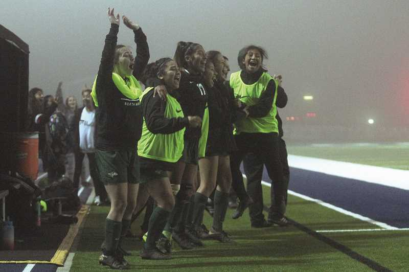 PMG PHOTO: PHIL HAWKINS - The North Marion bench erupts after junior Mya Hammack scored the game-winning goal on a penalty kick with nine seconds left in overtime to lift the Huskies to a 3-2 victory over Stayton in the first round of the state playoffs on Tuesday.