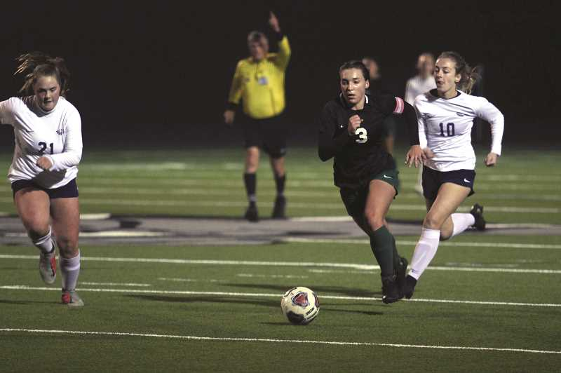 PMG PHOTO: PHIL HAWKINS - Mya Hammack assisted on the Huskies' second goal to put North Marion up 2-0 at halftime, but was hounded by Stayton defenders for the entirety of the game.