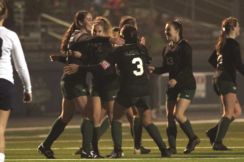 PMG PHOTO: PHIL HAWKINS - Carter Crawford celebrates with teammates after scoring in the 35th minute to put the Huskies ahead 2-0. Stayton would score twice in the second half to force overtime.