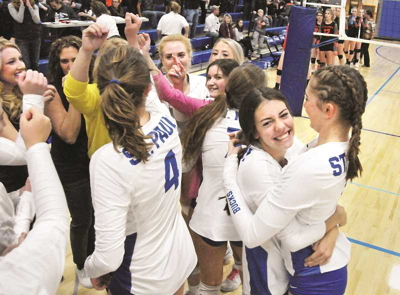 PMG PHOTO: GARY ALLEN - The St. Paul Buckaroos celebrate their return to the 1A state quarterfinal tournament after beating Wallowa 3-0 on Saturday. The Bucks are looking to defend their 2018 state title and add a second championship for the volleyball program.