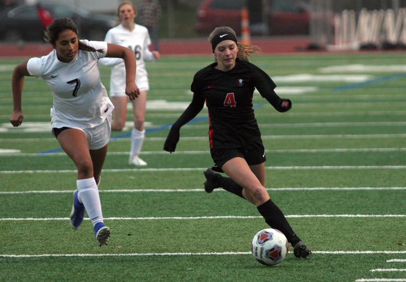 PMG PHOTO: JIM BESEDA - Gladstone's Brianna Lewis (4) scored four goals to help lead the top-ranked Gladiators to a 9-0 blowout over Mazama in Tuesday's opening round of the OSAA 4A girls soccer playoffs.