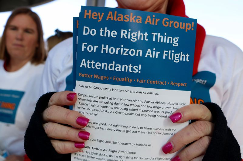 PMG PHOTO: ZANE SPARLING - Flight attendants with Horizon Air are employees of the Alaska Air group, but say they make less than similar workers for the larger carrier.