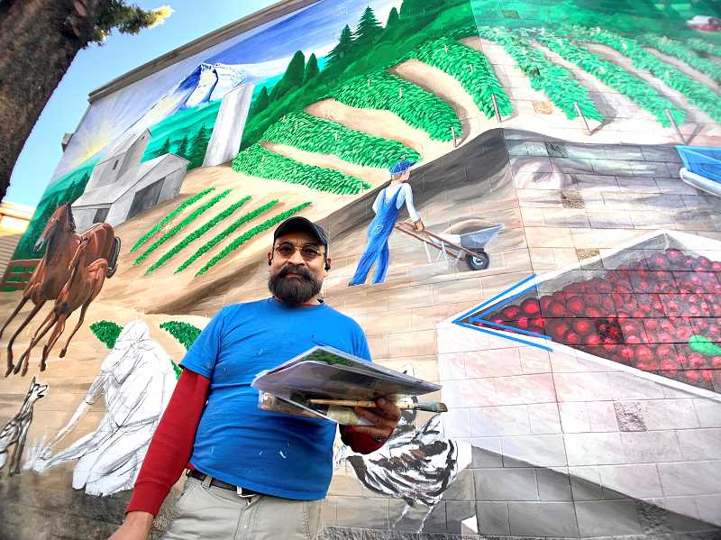 PMG PHOTO: JAIME VALDEZ - Long-time Portland-based muralist, Hector H. Hernandez, works on a painting project of extending the original mural to an additional 864 square feet for the incoming Wilco store on 17711 Jean Way, Lake Oswego.