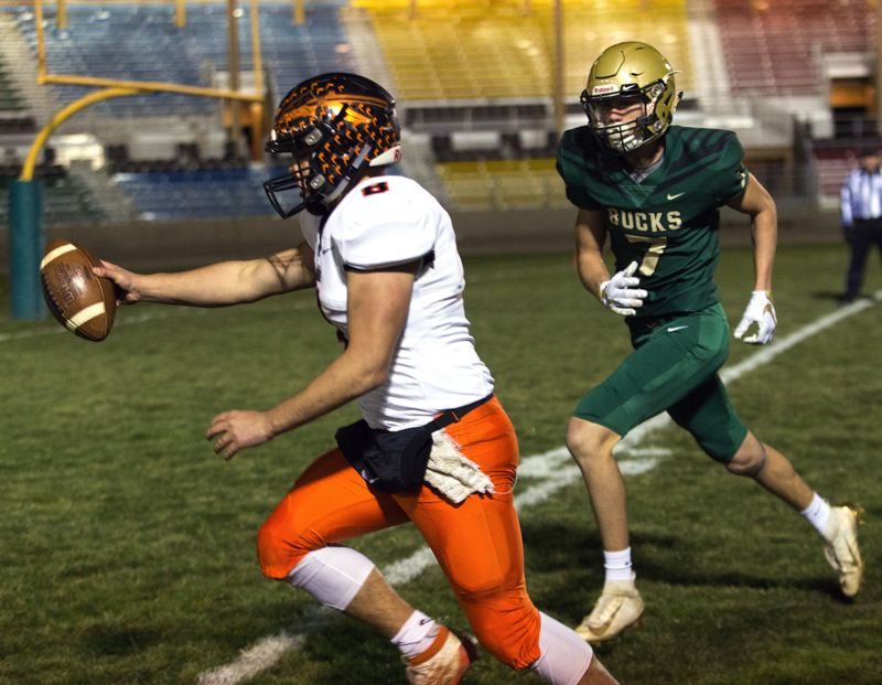 COURTESY PHOTO: KATHY ANEY/EAST OREGONIAN - Scappoose High quarterback Jakobi Kessi scores on the run early in last week's game at Pendleton's Round-Up Stadium.