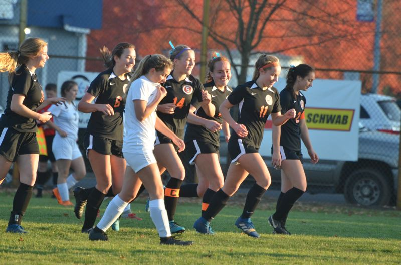 COURTESY PHOTO: JOHN BREWINGTON - Scappoose players enjoy a moment after their second goal in Tuesday's 2-0 victory at home over Springfield in the Class 5A playoffs. From left are Tessa Davidson, Grace Negelspach, Emma Jones, Taryn Verzino, Rylee Cook and Anika Havlik.