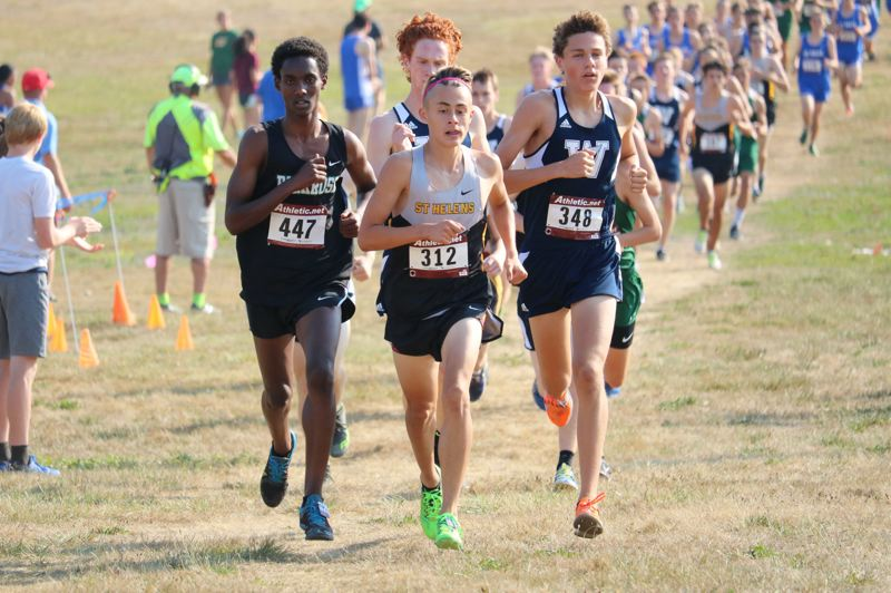 PMG FILE PHOTO - Waylon Nichols (center) of St. Helens will be back at Lane Community College on Saturday for his third run in the state championships.