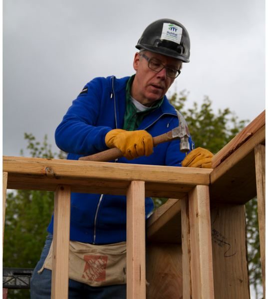 COURTESY: PORTLAND BUSINESS ALLIANCE - Greg Ness works on a Habitat for Humanity home-building project. His involvement with not-for-profits spans a wide range, from serving as a chair of boards of Oregon Business Council and the Armory Theater Fund to a role as a trustee emeritus of Portland Center Stages board and membership in the SOLVE Founders Circle.