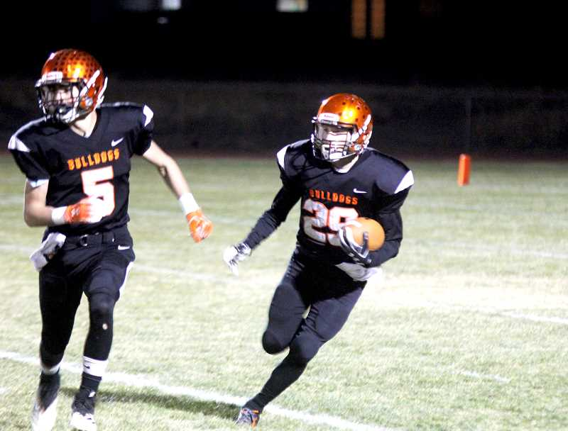 STEELE HAUGEN - Caden Engel, 29, follows lead blocker Jordan VanAlstyne,  during a kickoff return. Culver lost 12-8 to Sheridan Nov. 1, but still made the postseason. They are on the road against Knappa Nov. 8.