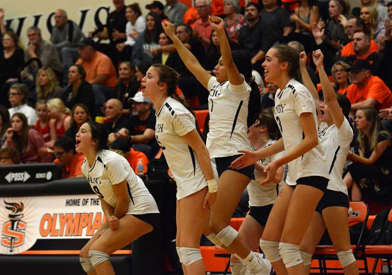 PMG PHOTO: DEREK WILEY - Canby's volleyball team celebrates during the fifth set of their match against Sprague in round 2 of the state tournament. The team beat Sprague to advance to bracket play at Liberty.
