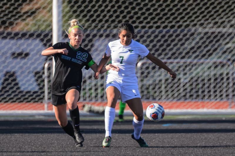 COURTESY PHOTO: CHRISTOPHER GERMANO - Tigard High School senior Steffani Rodriguez (right) controls the ball against West Salem senior Paige Alexander during the state-playoff first-round match.