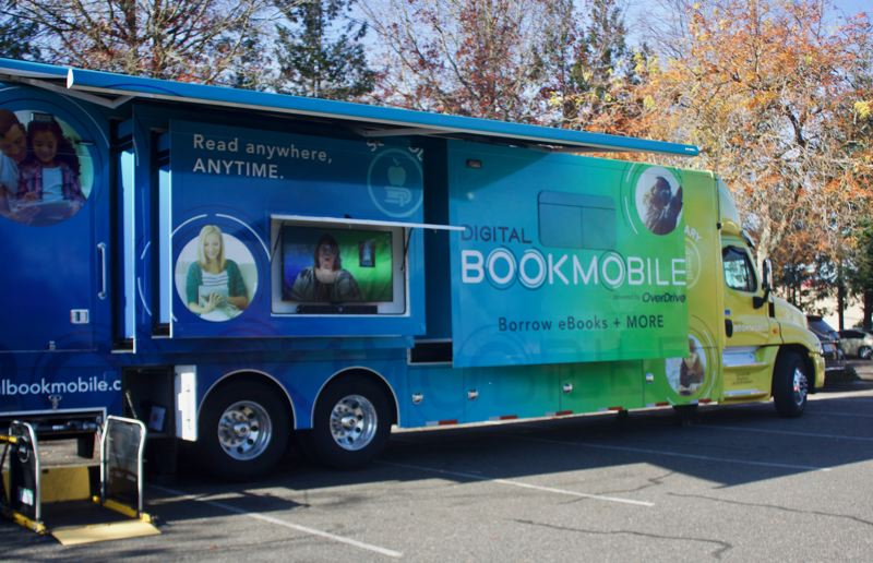 PMG PHOTO: CHRISTOPHER KEIZUR - The Digital Bookmobile visited Gresham to promote the electronic reading options available through your library card.