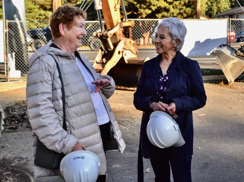PMG PHOTO: BRITTANY ALLEN - Outside In former director Kathy Oliver and current Executive Director, Patricia Patron, were among those who ceremoniously broke ground on Oct. 23 at the new Rosewood health clinic site.