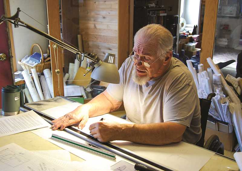 RAMONA MCCALLISTER - George McCart working in his office on a house plan. McCart does all his work by hand, including his architectural drawings.