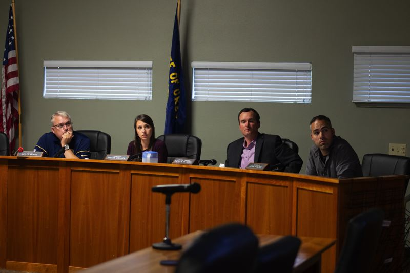 PMG PHOTO: ANNA DEL SAVIO - Scappoose Mayor Scott Burge and Councilors Megan Greisen, Patrick Kessi, and Josh Poling watch a presentation from consultants at a meeting earlier this year.