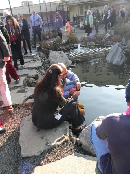 OREGON CAPITAL BUREAU: JAKE THOMAS - Department of Corrections Director Colette Peters and Johnny Cofer, a member of the OSP Asian Pacific Family Club, feed Koi at the Oregon State Penitentiary Memorial Healing Garden.