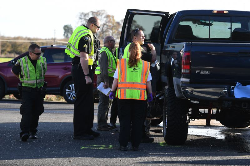 PMG PHOTO: CHRISTOPHER OERTELL - First responders on the scene of a fatal crash between two pick up trucks on Highway 8 at Northwest 334th Avenue between Hillsboro and Cornelius on Thursday, Nov. 11.
