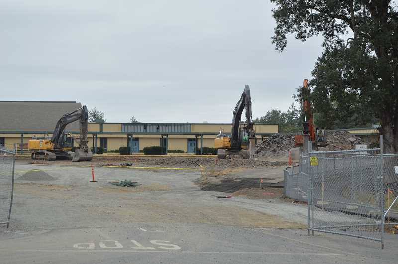 PMG FILE PHOTO - Demolition of the former St. Helens Middle School occurred in early summer. A lawsuit filed the St. Helens School District last week argues the company hired to remove asbestos from the building prior to demolition failed to do so.