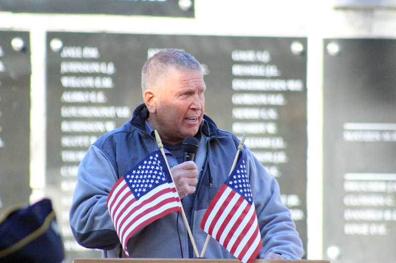 PHOTO COURTESY OF NICOLE THILL-PACHECO - Gene Hester of VFW Post 1440 speaks at the Veterans Memorial Plaza expansion dedication ceremony in St. Helens' McCormick Park on Friday, Nov. 11.