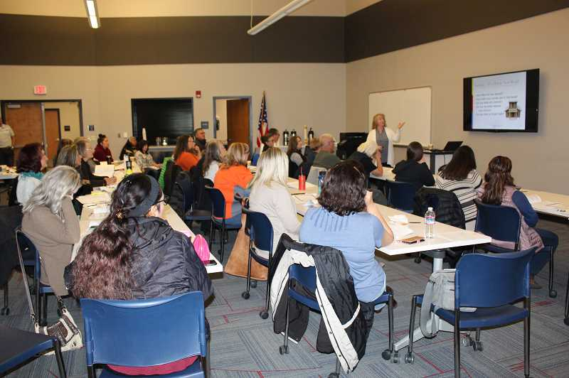 SUBMITTED PHOTO - Laurie Steele, Marion County treasurer, presents a  training course on Oct. 31. A total of 72 people learned about best practices for handling cash and maintaining records at the Madras Performing Arts Center.