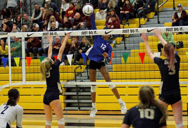 PMG PHOTO: WADE EVANSON - Valley Catholic's Naima Foster goes up for a kill during the Valiants state tournament game against Banks Friday morning, Nov. 8, at Forest Grove High School.