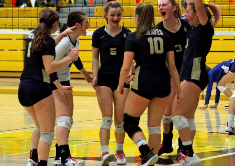 PMG PHOTO: WADE EVANSON - Members of the Banks volleyball team celebrates a point during the Braves' state tournament game against the Valiants Friday morning, Nov. 8, at Forest Grove High School.
