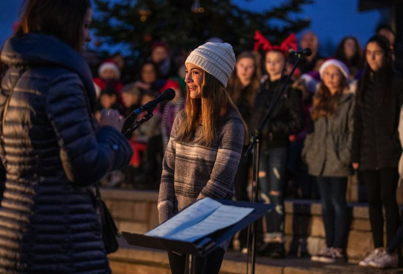 PMG FILE PHOTO - Madeline Green sings with the Laurel Ridge Middle School choir during the Sherwood Tree Lighting last year.