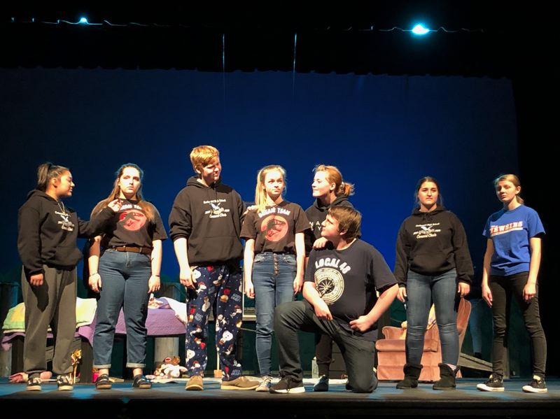 COURTESY PHOTO: KELLIE MCCARTY - Centennial High School junior Beatrice Byrd, center, who stars as Wendy, rehearses with cast members for Lost Girl.