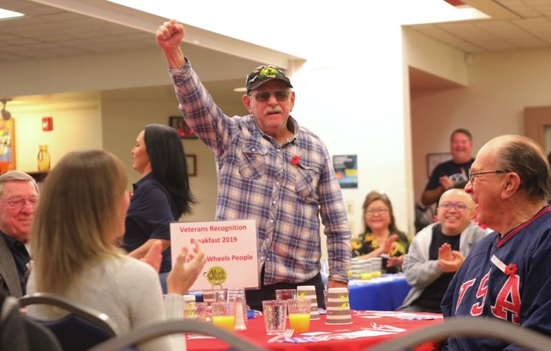 PMG PHOTO: JAIME VALDEZ - Wesley Williams, a U.S. Marine Corps veteran, stood with a hearty 'ooh-rah' as veterans from different service branches were recognized Friday, Nov. 8, at the Juanita Pohl Center in Tualatin. Williams says he is homeless.
