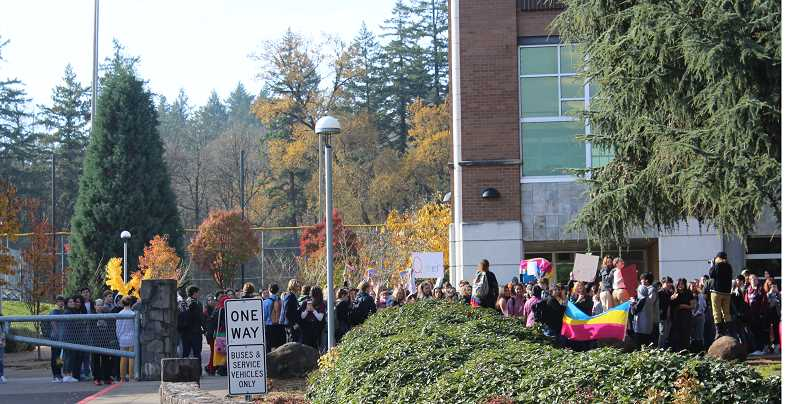 PMG PHOTO: HOLLY BARTHOLOMEW - Students from West Linn High School gathered in support of LGBTQ students at a walkout hosted by the Gay-straight Alliance