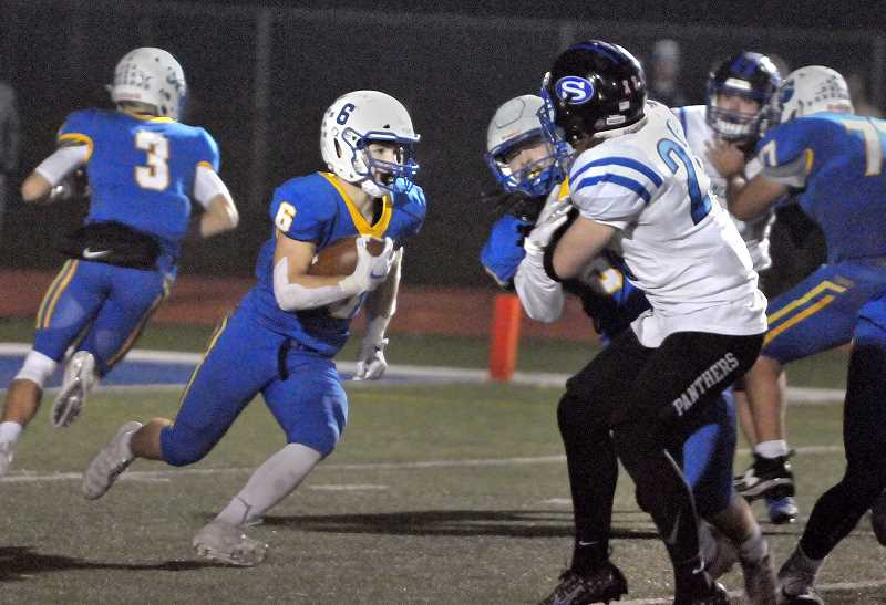 GRAPHIC PHOTO: GARY ALLEN - The Tigers' running game, a strong point for the team all season, continued unabated in Newberg's 28-0 win over the Panthers Friday evening at home.