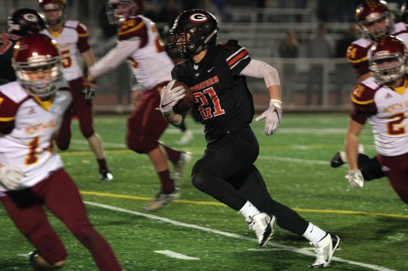 PMG PHOTO: JIM BESEDA - Gladstone senior running back Mason Scheehean had 16 carries for 255 yards and four touchdowns, leading the Gladiators to a 51-14 win over North Valley in Friday's 4A playoff opener.
