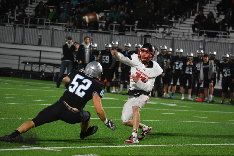 TIMES PHOTO: MATT SINGLEDECKER - Clackamas senior quarterback Austin Atkeson fires a pass into the flat against Mountainside.