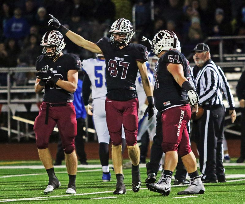 PMG PHOTO: DAN BROOD - Sherwood High School senior Blake Jensen (87) points the Bowmen's direction after recovering a McNary fumble during Friday's state playoff first-round game.