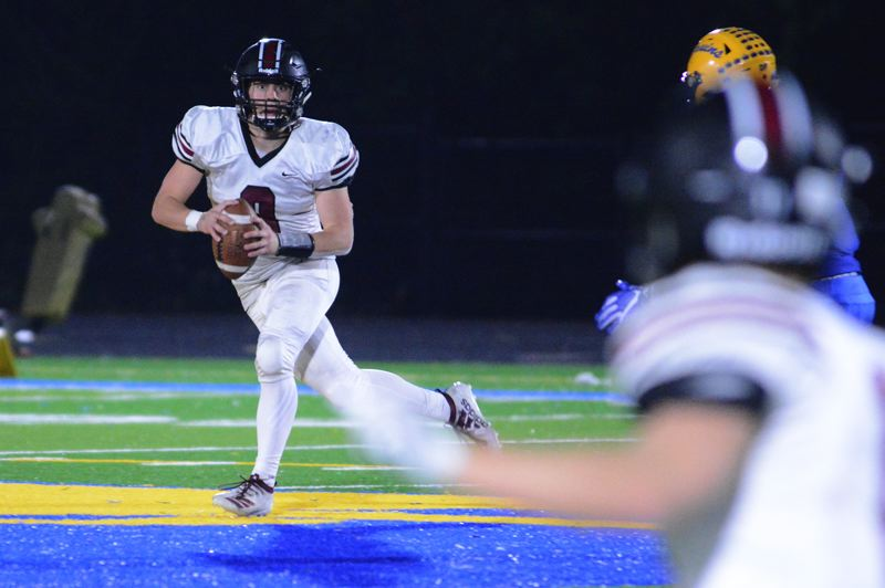 PMG PHOTO: DAVID BALL - Glencoe QB Carson Wilson rolls out searching for a receiver during Fridays 19-14 loss to Barlow.