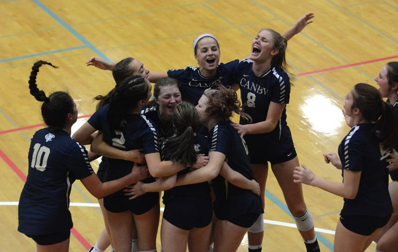 PMG PHOTO: DEREK WILEY - Canby celebrates after defeating West Linn 3-0 to place third at the Class 6A volleyball tournament.